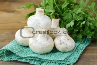 mushrooms champignon on a wooden table