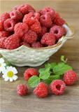 juicy ripe raspberries with mint leaves
