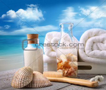 Fluffy towels with bath accessories at the beach