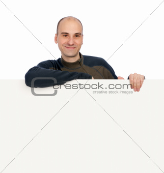 smiling young handsome man with blank banner
