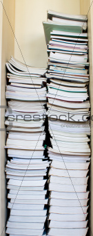 High stack of used books