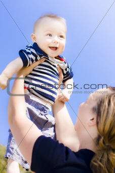 Happy baby held up to the sky