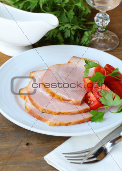 Baked ham served with lettuce and herbs