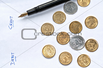 Closeup  accounting pen coins isolated copy space