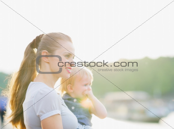 Portrait of mother and baby looking on copy space