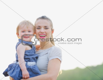 Portrait of smiling mom and baby
