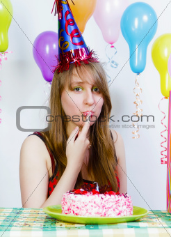 Birthday. A young attractive girl eating cake