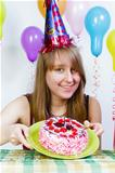 Birthday. A young attractive girl with cake