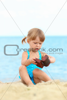 little girl on the shore of the sea