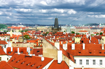 Prague roofs and cloudy sky