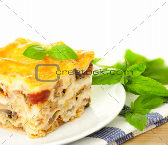 Delicious Italian Lasagna / with fresh basil / white background