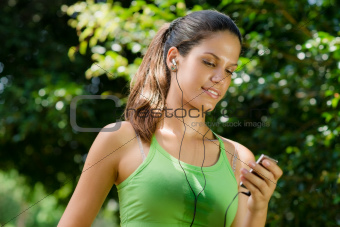 woman with mp3 player listening to music and jogging