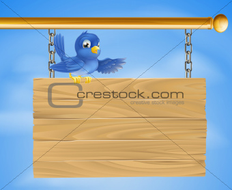 Blue bird on wooden sign