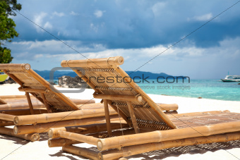 Wooden deck chairs on beach