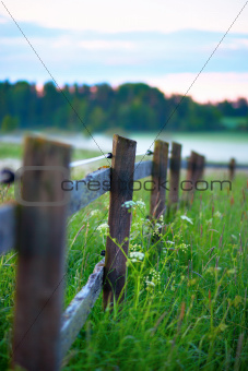 Wooden fence with fog