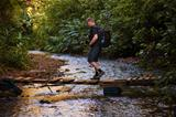 Hiker Crosses Stream