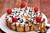Photo: Cheesecake Decorated With Chocolate And Strawberries
