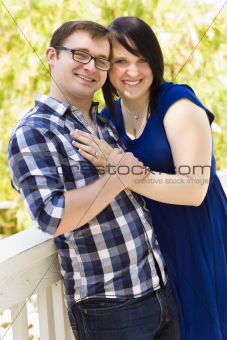 Attractive Young Couple Having Fun Outside in the Park Portrait.