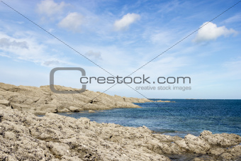 rocky coast of northern France against the blue sky