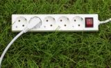 an power strip lying on the grass