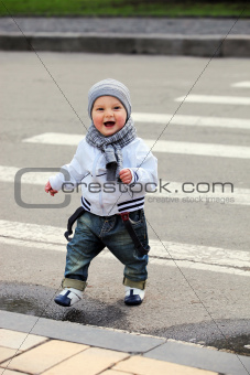 Little boy crossing a street