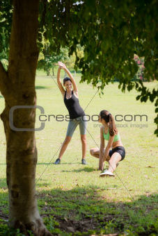 Sports, pretty female friends relaxing after jogging