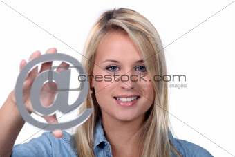 Girl holding @ sign
