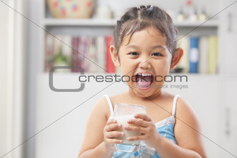 Little girl happy after drinking milk