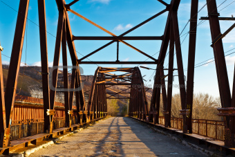 Old Rusty Bridge across Volga River near Samara, Russia