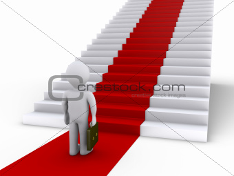 Businessman in front of stairs with red carpet