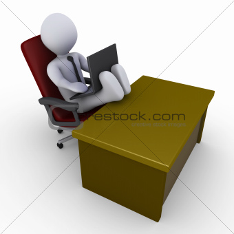 Businessman with feet on desk working with laptop