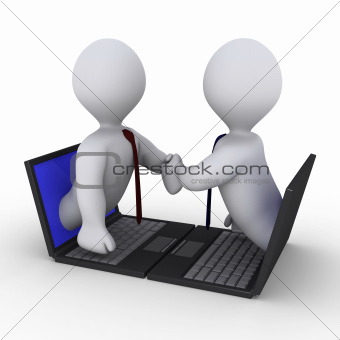 Businessmen handshake through laptop