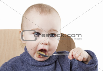 baby eating applesauce