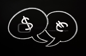 Two speech bubbles for Dollar and Euro dialogue on a blackboard