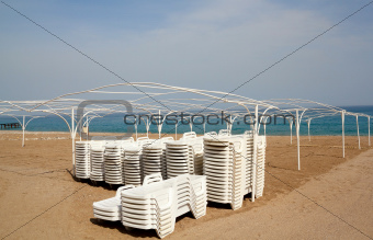 Empty beach with sun lounger
