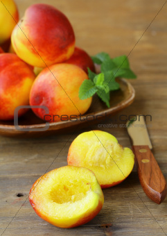 red ripe peaches on wooden table