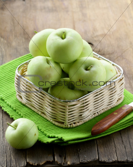 green ripe organic apples in the basket