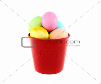Colorful Easter eggs in a red bucket.