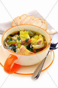 Fish soup in a bowl on a white background.