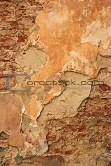 Old brick wall with ragged plaster