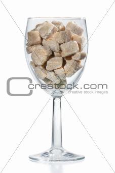 Wine glass of brown sugar.