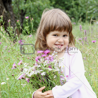 Playful Girl with Bunch of Wild Flowers
