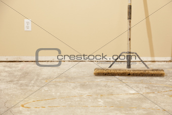 Blank Concrete House Floor with Broom Ready for Flooring Installation.