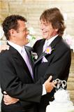 Gay Wedding Couple Embrace