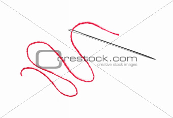 Red thread and needle isolated on white