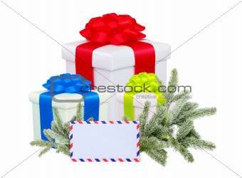 christmas gifts with post card and branch firtree isolated on wh