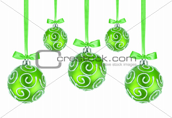 Green Christmas balls with bows on white background