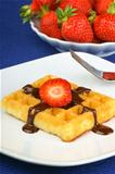 Waffle with chocolate and strawberry