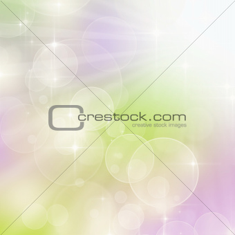 A bright spring background with green and pink bokeh effects