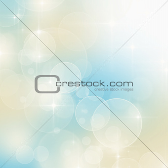 Abstract blue and beige bokeh background with copy space